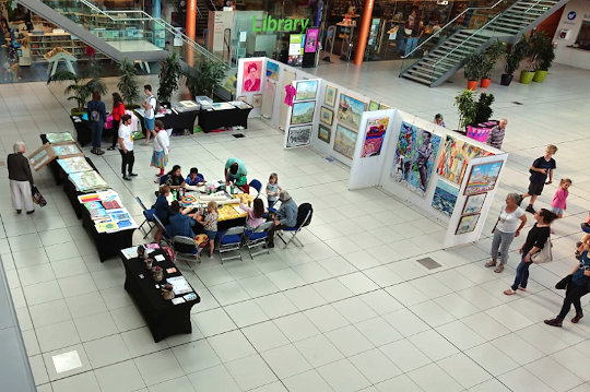An overview photo of the Fantabulousa event at the forum, wich the drawing table in the centre.