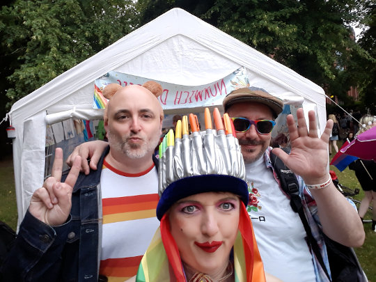 A selfie with two men visiting the Norwich Dandies tent at Pride 2019. (c) 2019 by Eloise O'Hare.