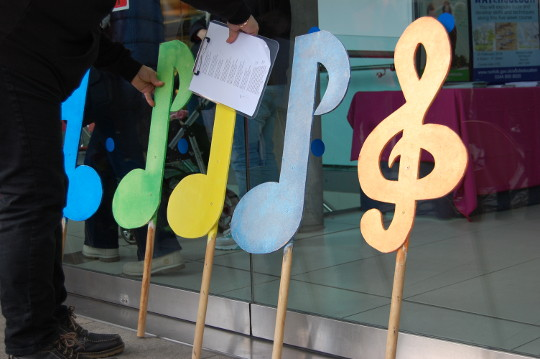 Large, colourful musical notes made of wood.