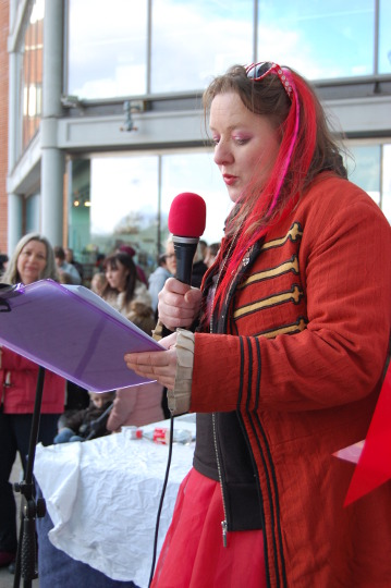 Eloise O'Hare addressing the crowds outside the Forum.