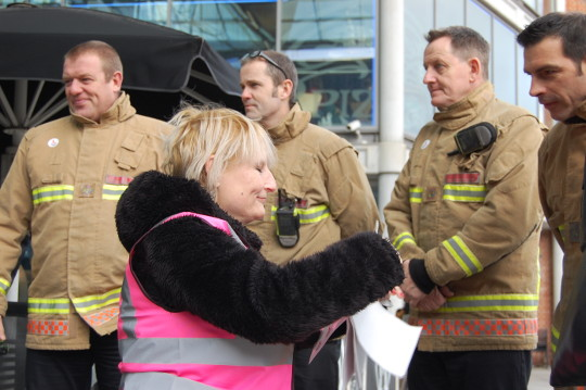 Maria and a group of firemen.