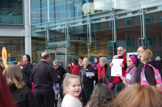 The Pride Choir performing outside the Forum.