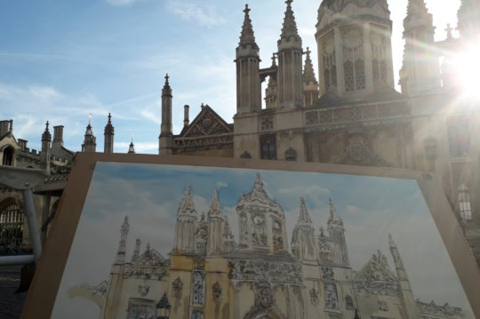 A photo of King's College in Cambridge, with my watercolour painting of the building in the foreground. (c) by Eloise O'Hare.