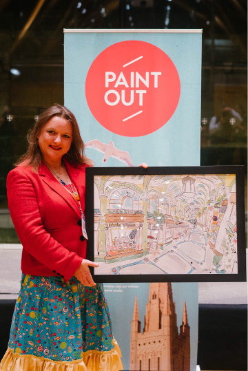 Eloise O'Hare on stage with the prize-winning painting.