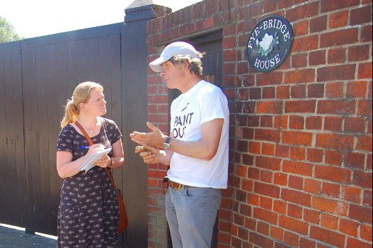 Artist James Colman and EDP journalist Emma Knights talking in front of Fye Bridge House.