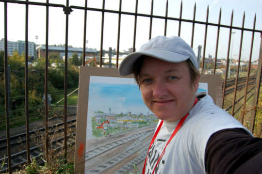 A selfie of me with the painting of railway tracks near Norwich station. (c) 2017 by Eloise O'Hare.