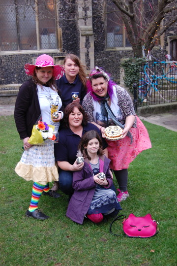 Another group shot, with cakes and flowers.