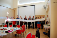Participants at an ABCD event holding up the graphic reporting scroll. (c) Eloise O'Hare.